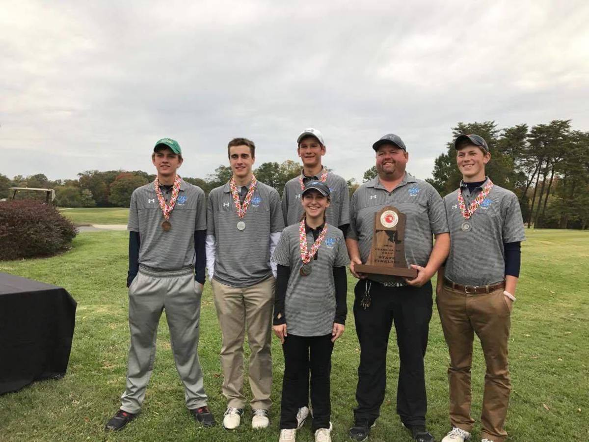 The golf team poses for a photo with their second place medals. Pictured are (left to right) Dugan McCabe, Joey Squeri, Chandler Kuhn, Amanda Levy, Coach Karl O'Donoghue, and Elliot Snow. Photo by Joey Squeri