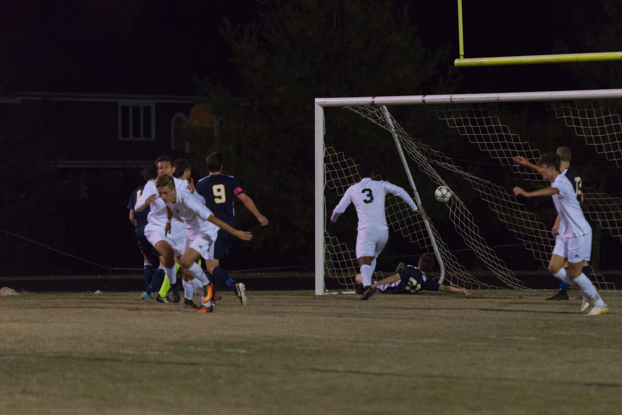 Forward Andreas Djurhuus heads in one of his two goals in the first half against B-CC. Photo by Jefferson Luo.