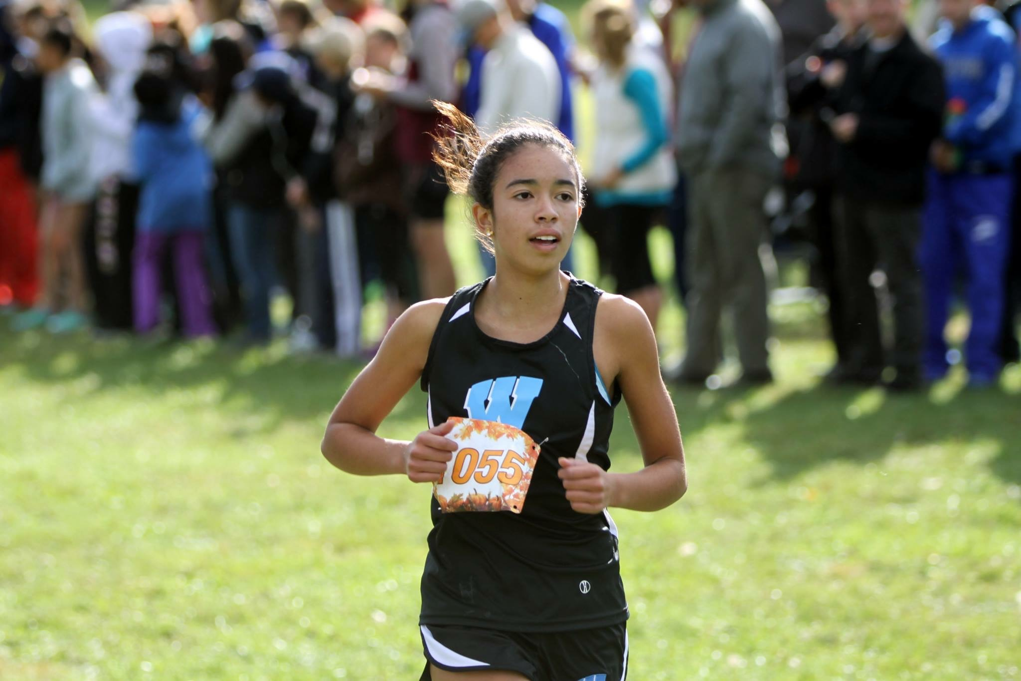 Freshman Paula Bathalon races at the county championships on Oct. 22. Bathalon finished 17th in the state in the three mile race. Photo courtesy MoCo Running