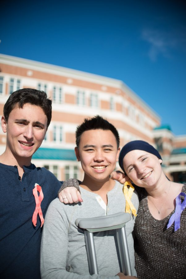 Juniors+Matthew+Simon+and+Olivia+Matthews+and+senior+Jaiwen+Hsu+have+different+color+ribbons+that+represent+the+different+types+of+cancer+they+had.++Photo+by+Tomas+Castro.