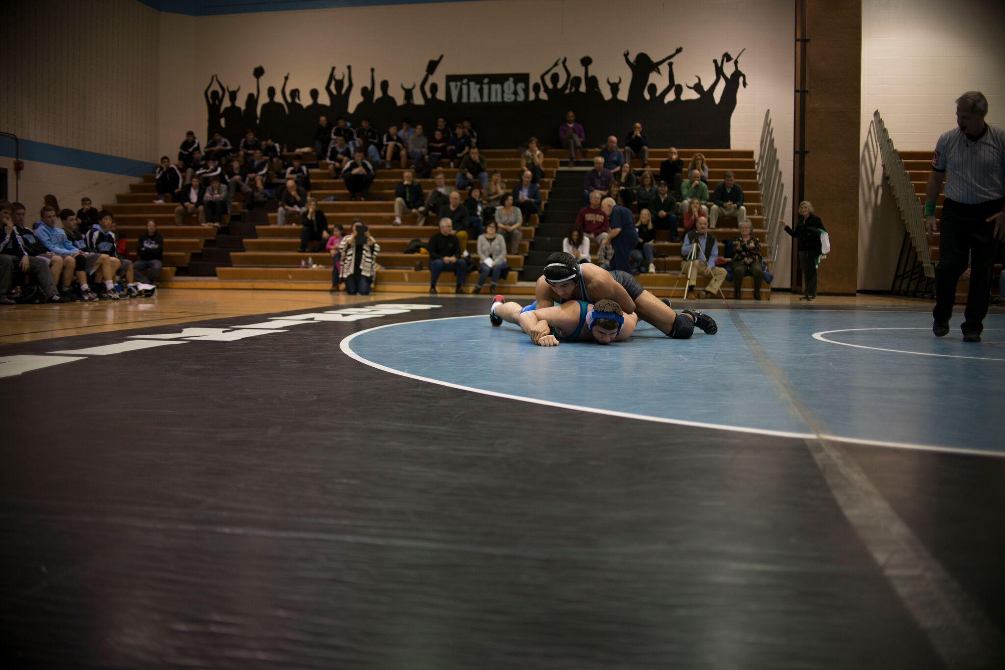 Wrestler John Luke Iglesias pins his Churchill opponent in Thursday's match. Photo by Annabelle Gordon.