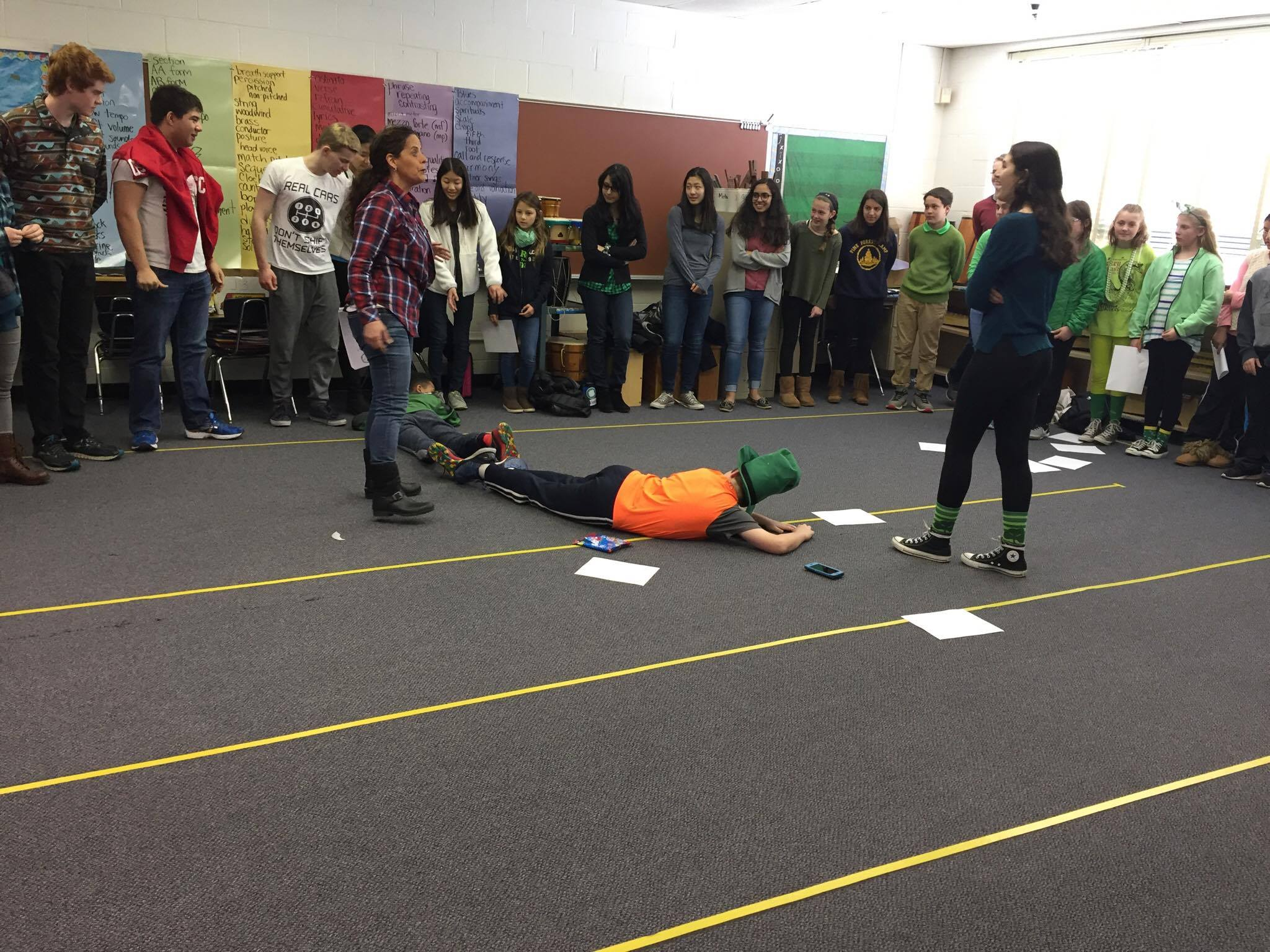 For the diameter activity, 13 students lined up as the diameter of a circle with a circumference of 39 people. Students discovered that the diameter went around the circle approximately three times, which is close to pi. Photo by Pearl Sun.