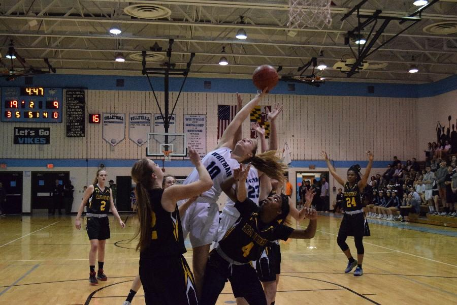 Guard Abby Meyers grabs a contested rebound during her 26 point outing against RM. Photo by Rachel Hazan.