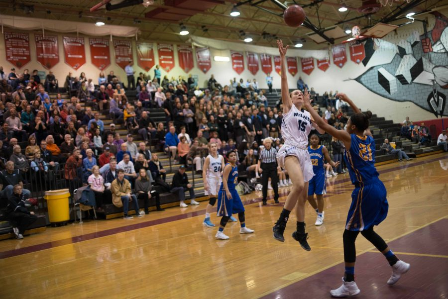 Guard+Isabel+Manzano+goes+up+with+a+hook+shot+in+the+team%27s+regional+final+victory+over+Gaithersburg.+Photo+by+Tomas+Castro.