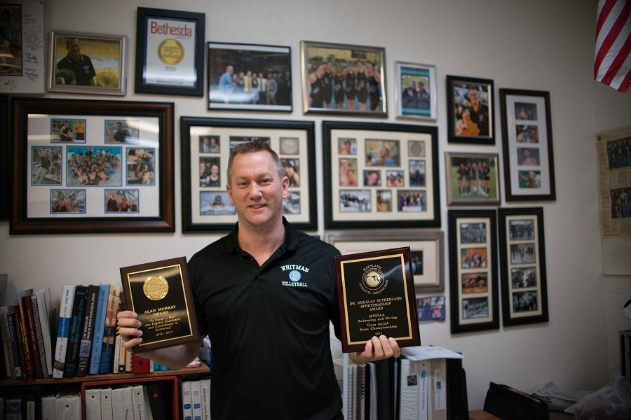 Swim and dive coach Geoffrey Schaefer received two awards March 2, capping a long career. Photo by Tomas Castro.