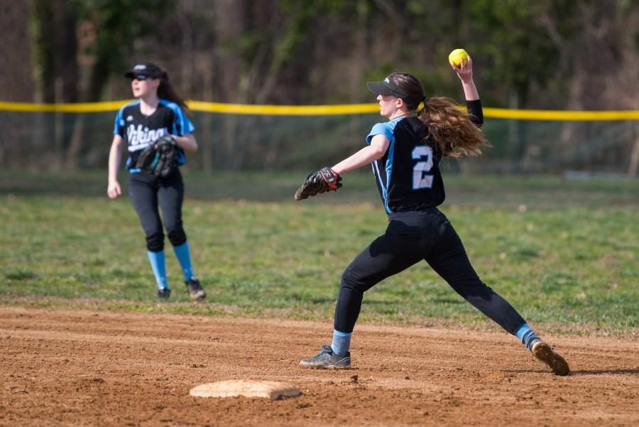 Infielder+Laura+May+throws+the+ball+across+the+diamond+in+the+team%27s+17%E2%80%934+loss+against+Seneca+Valley.+Photo+by+Jefferson+Luo.