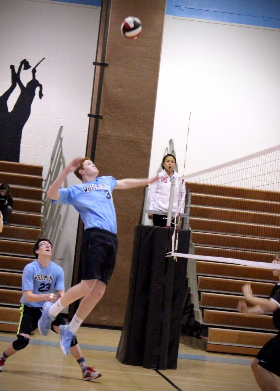 Junior Jack Farren goes up for a smash in coed volleyball's sweep over RM. Photo by Olivia Matthews.