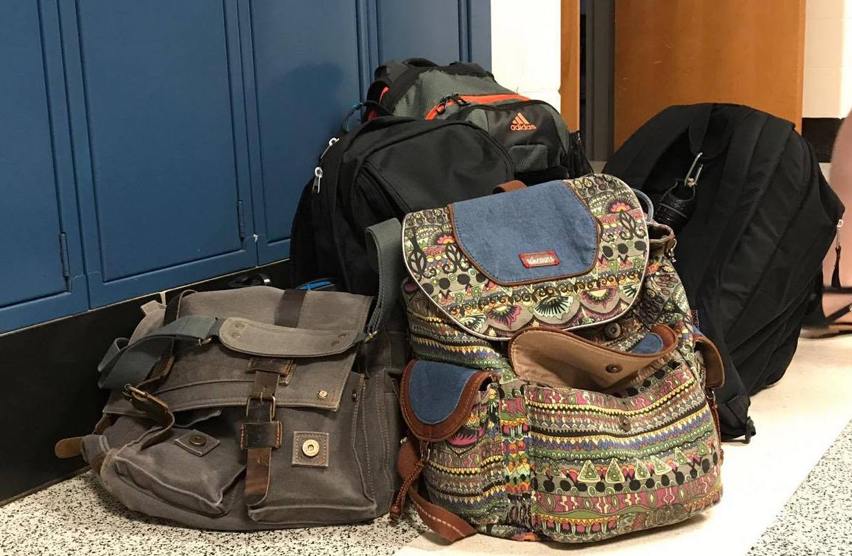 Donated+backpacks+lay+in+Whitman%27s+front+entrance.+Senior+Sarah+Bruegmann+helped+ice+cream+truck+driver+AJ+Jalloh+with+a+project+sending+backpacks+to+children+in+Sierra+Leone.+Photo+by+Sydney+Miller.+