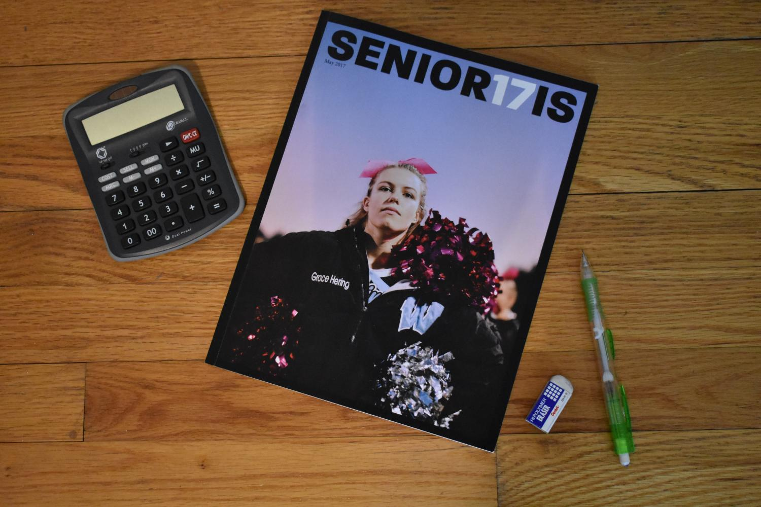The+magazine+titled+%22SENIOR17IS%22+features+cheerleader+Grace+Hering+at+a+football+game+on+the+cover.+Castro+designed+the+magazine+using+the+program+InDesign+and+finished+it+finished+in+May.+Photo+by+Mira+Dwyer.+