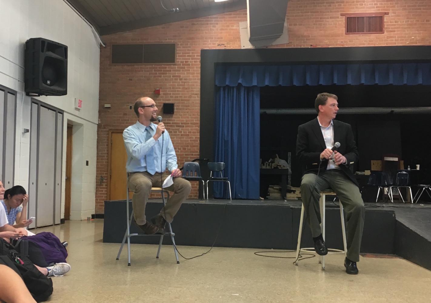 AP Government teacher Colin O'Brien (left) and same-sex marriage lawyer Douglas Hallward-Driemeier (right) address students in the auditorium. Hallward-Driemeier told students about his experiences appearing before the Supreme Court 16 times. Photo by Eva Liles.