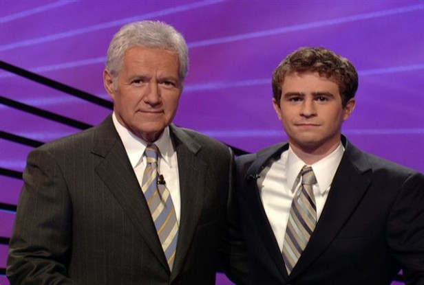 Adam Marshall poses with Jeopardy host Alex Trebek for one of the episodes he competed in to win $53,800. Marshall credits his success partly to his time on the Its Academic team at Whitman. Photo courtesy Adam Marshall.