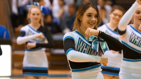 Junior Issie Griffith cheers at a basketball game Monday. The girls .............. Photo by Billy Bird.