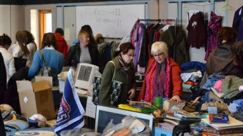 Parents and neighbors browse through the offerings at the school yard sale Sunday. The sale, hosted by the G.U.Y.S. club, is the first of its kind. Photo by Abigail Cutler.