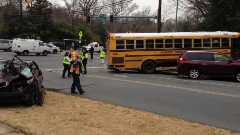 A MCPS schoolbus collided with two cars at the intersection of River Rd. and Whittier Blvd. Photo by Carolyn Freeman.