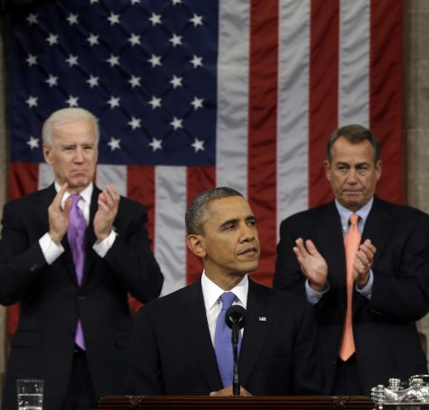 President Barack Obama stands between Vice President Joe Biden and House Speaker John Boehner as he gives his State of the Union address. AP Photo/Charles Dharapak, Pool.