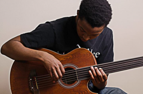 Senior Charles Augustine poses with his bass for a competition that could win $10,000 for the music department. Photo courtesy Charles Augustine.
