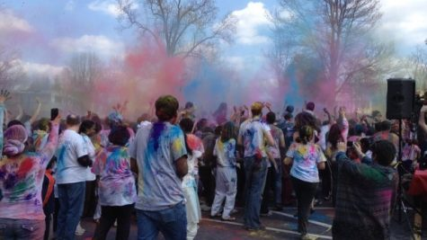 Revelers throw colored powder in the air to celebrate Holi. Photo by Julia Medine.