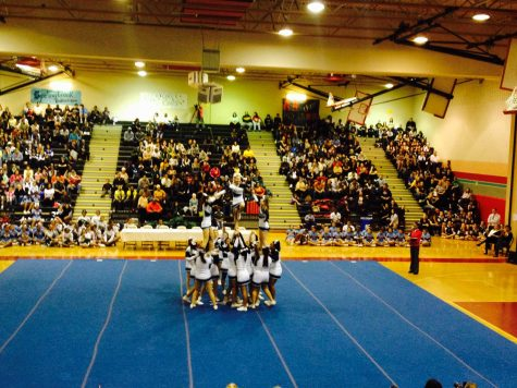 Cheerleading performs at the Montgomery County Division III Cheerleading competition at Blair High School Saturday. Although the girls did not place, their performance roused applause from several Whitmaniac fans.