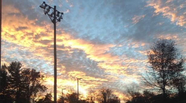 Sunset over the baseball field area.