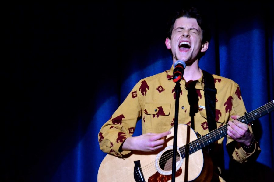 Junior Lucas Weals performs In the Curve by The Avett Brothers. Weals was one of 12 students who participated in Whitman Idol Friday night.