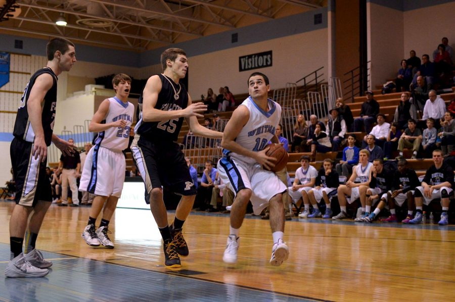 Senior Adam Joel successfully dodges an opponent in yesterday's game against Poolesville. Whitman won 53-48. Photo by Abby Cutler.