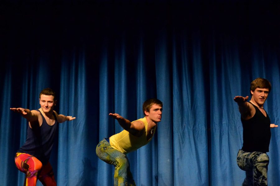 Seniors Jeff Marr, Harrison Holt and Grant Payette (left to right) perform yoga poses while scantily clad in tight pants and sleeveless shirts. The three seniors earned $750 for the Leukemia & Lymphoma Society for a date to hot yoga and lunch. Photo by Abby Cutler.