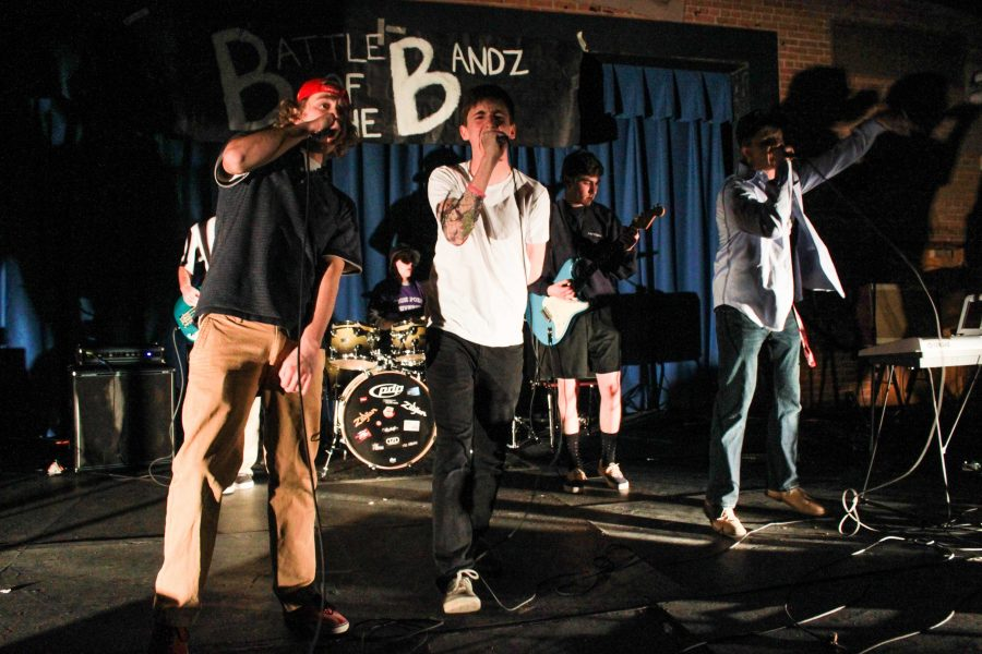 Six senior boys perform No Sleep Till Brooklyn by the Beastie Boys, which amped up the crowd at Battle of the Bands Wednesday night. Photo by Tyler Jacobson.