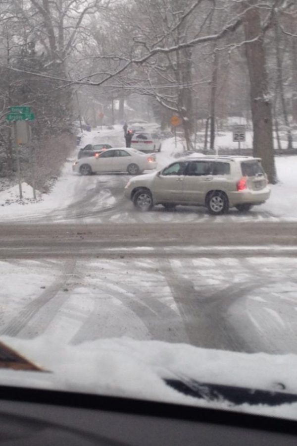 Multiple cars spun-out on Raybrun Rd. during Wednesday morning's snowstorm. Photo courtesy Allison Frank