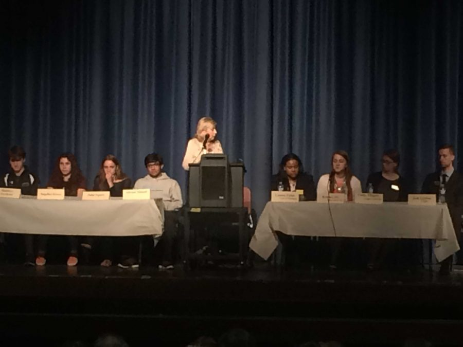 Mrs. Landau, a group of seniors and four college admissions officers answer questions at the