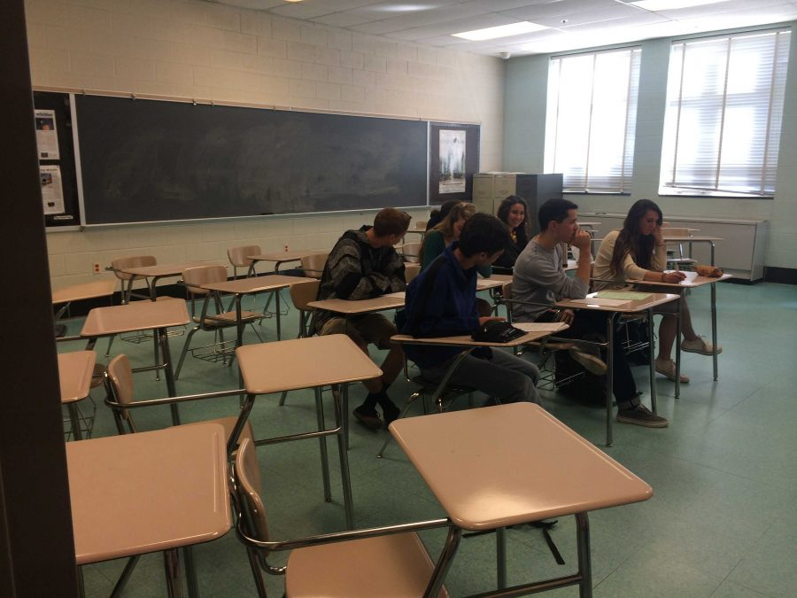 Only 6 out of 22 seniors were present in Mrs. Crewdson's third period AP Lit class.  Many students are absent today, Easter Monday, as it was originally part of spring break.  The county added an extra day to make up for the numerous snow days.  Photo by Julia Pearl-Schwartz.