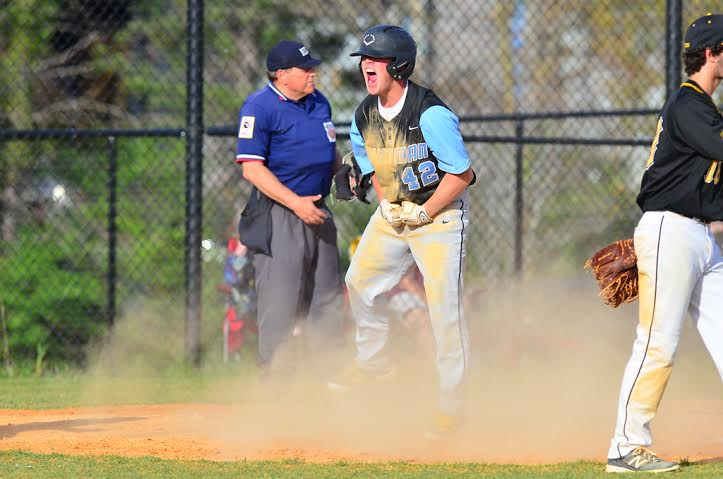 Third baseman Tyler Demartino lets loose after fueling a six run seventh inning to secure the Vikes' victory. Photo courtesy Whitman baseball.