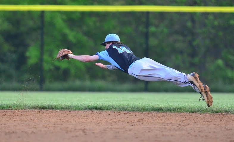 Second baseman Sean Hannegan fully lays out for a ground ball in the fourth inning. Photo courtesy Whitman baseball.