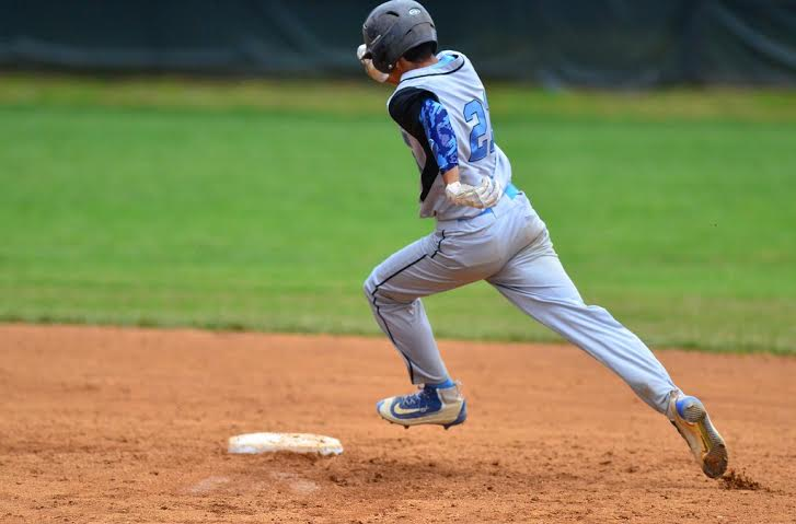 Outfielder Noah Clement legs out a triple against Northwood. Photo courtesy Whitman baseball.