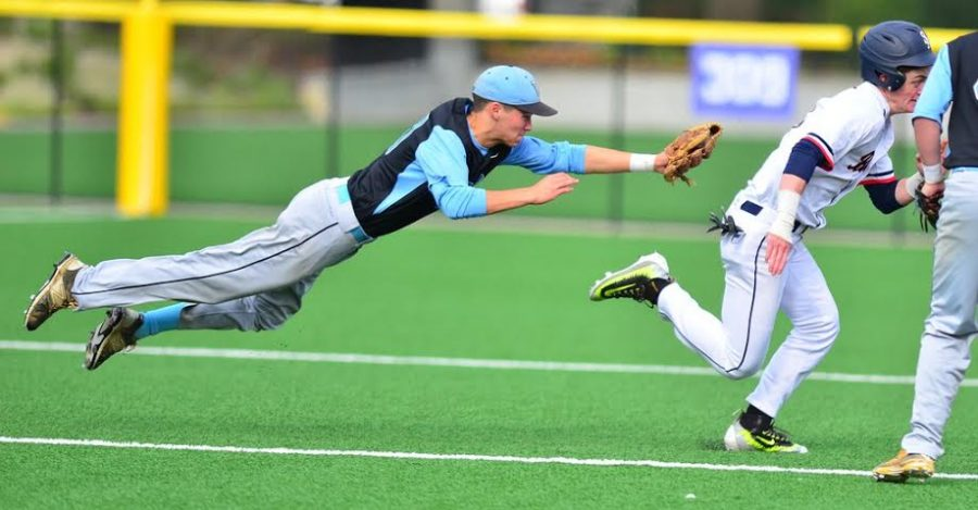 Shortstop Ian Atkinson dives to tag out the St. Albans runner in the fifth inning. Photo courtesy Whitman baseball.