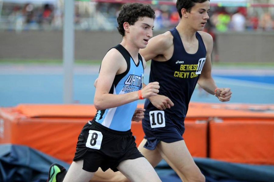 Distance runner Josh Engels looks to pass a B-CC runner in the 3200 race. Photo courtesy Moco Running.