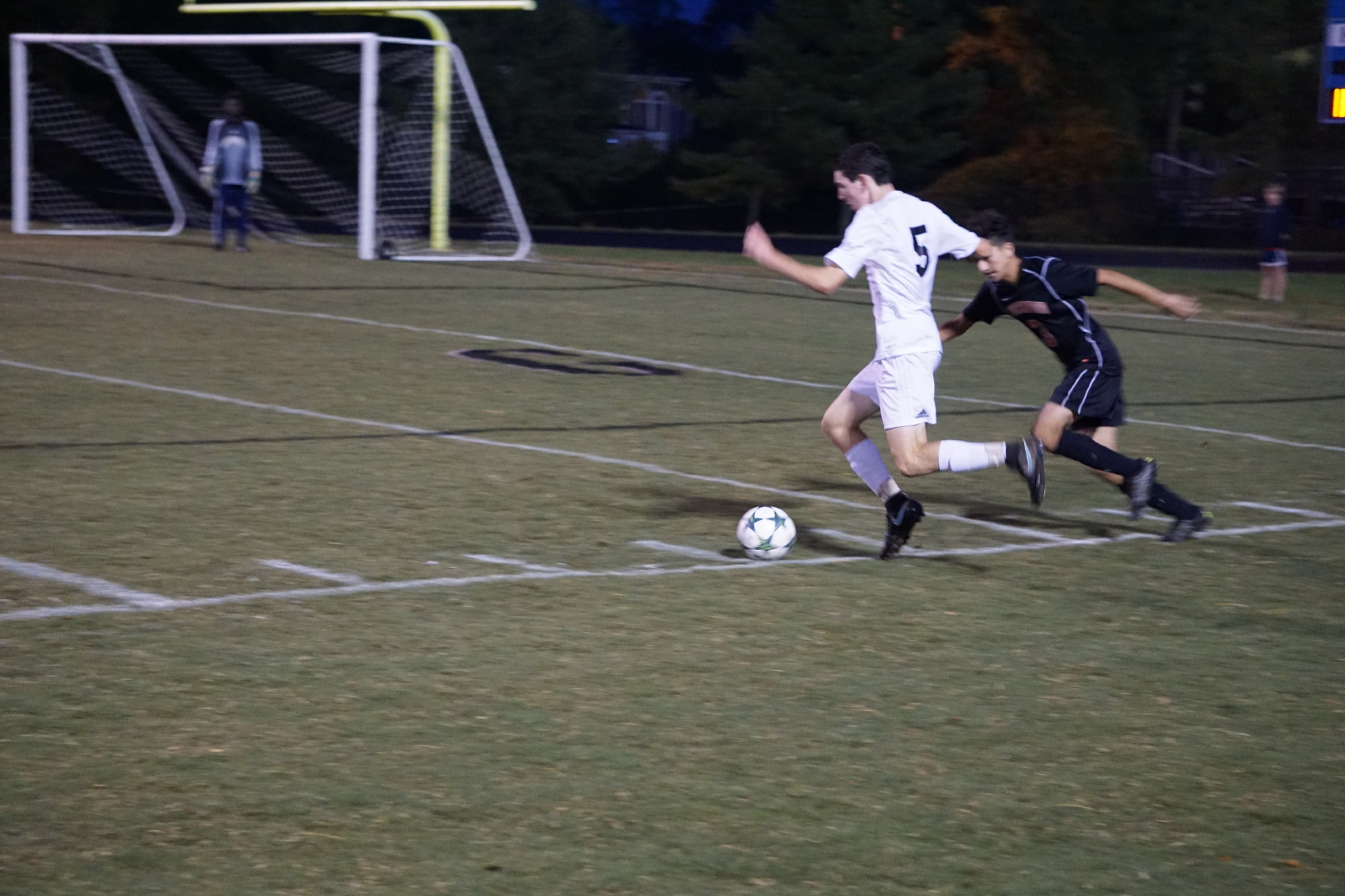 Defenseman Kevin Kaufman looks to cross the ball over the middle of the field in the team's 3–0 victory over Northwood. Photo by Lauren Gates.