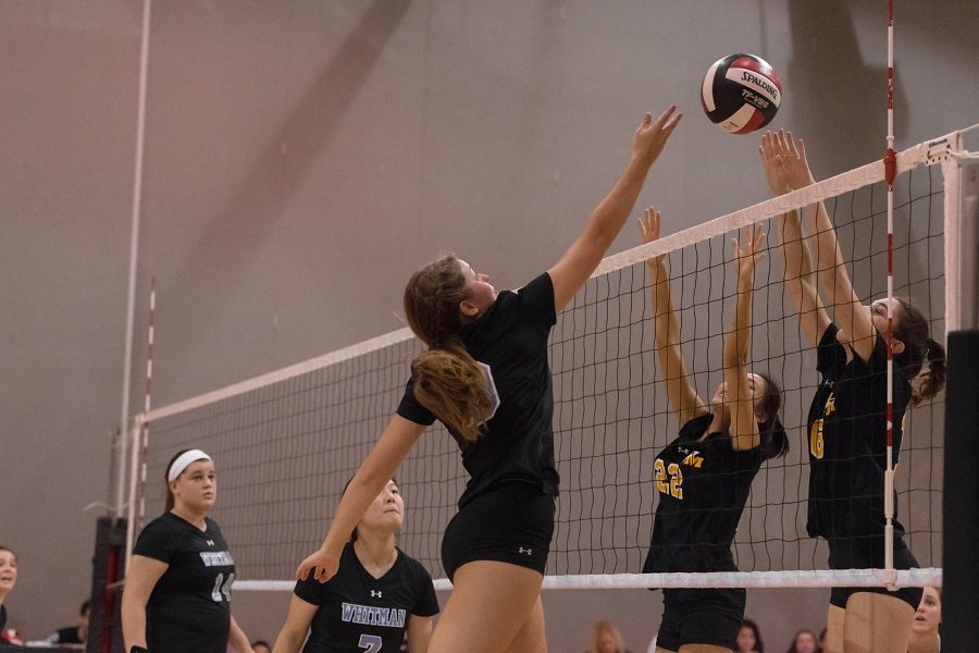 Hitter+Maddie+McGill+goes+for+a+spike+in+the+team%27s+3-0+loss+to+RM.+Photo+by+Jefferson+Luo