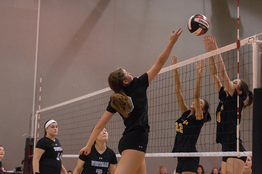 Hitter Maddie McGill goes for a spike in the team's 3-0 loss to RM. Photo by Jefferson Luo