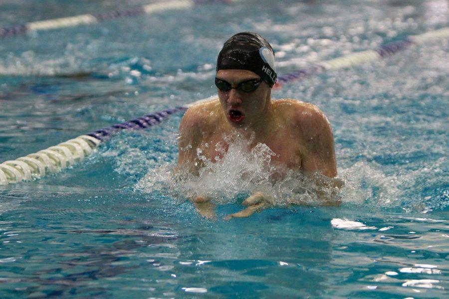 Junior Stefan Heller swims breaststroke at the team's preseason meet against QO. Photo by Tomas Castro.