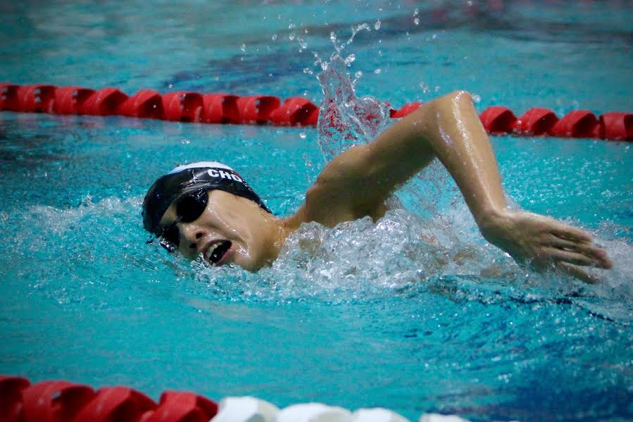 Junior Kyle Cho swimming freestyle in the team's victory over WJ. Photo by Olivia Matthews.