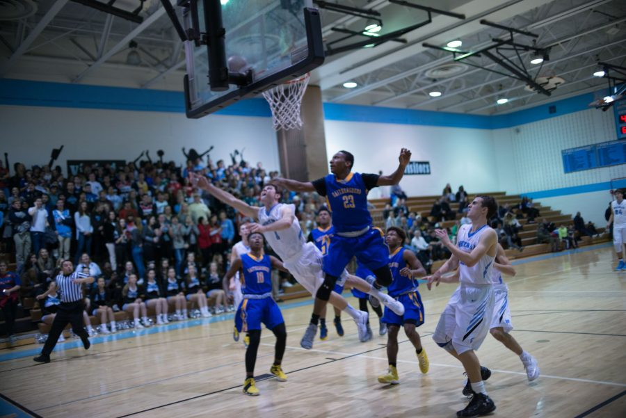 Guard Jack McClelland goes up for a contested layup against Gaithersburg. Photo by Tomas Castro.