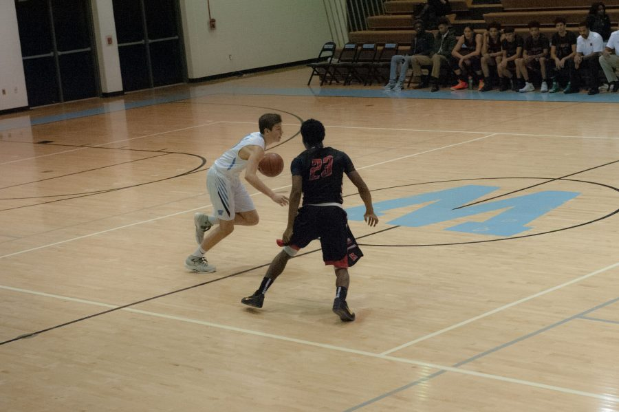 Guard Brendan Shaver dribbles past halfcourt in a dominant 20–4 fourth quarter. Photo by Katherine Luo.