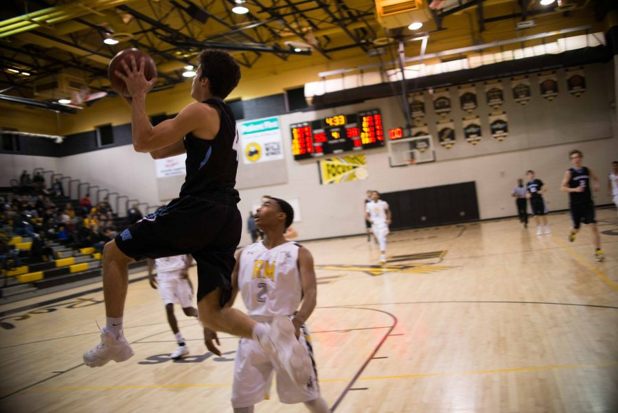Guard Alex Sanson soars across the baseline late in the second half against RM. Sanson noticed 11 points in the game. Photo by Tomas Castro.