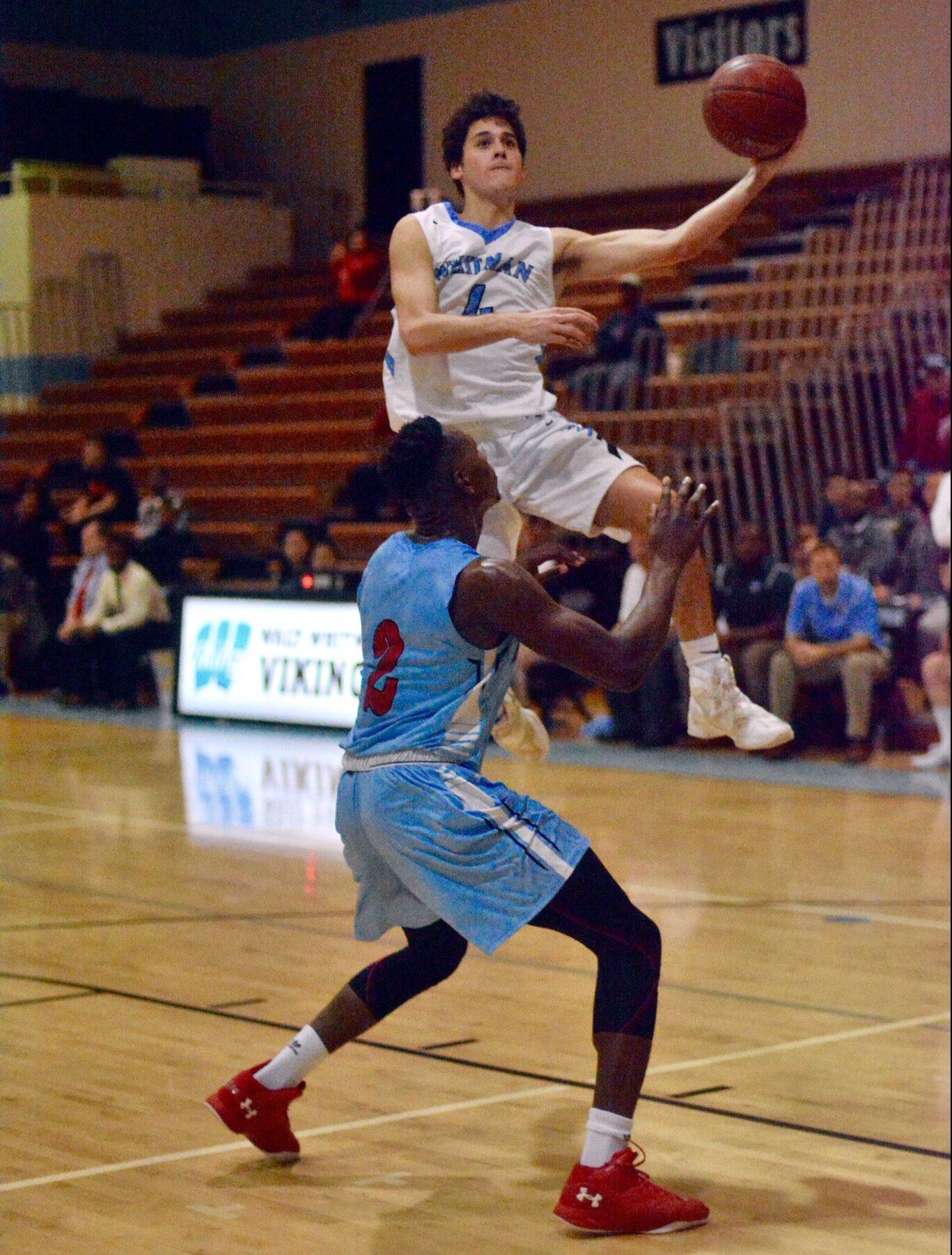 Guard Alex Sanson attacks the basket for a team-high 18 points in a tight contest against Einstein. Photo by Lauren Oppenheim.
