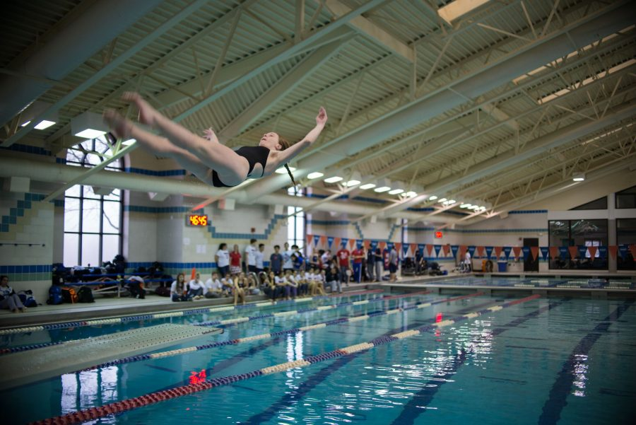 Diver Caroline LaPlante performing a twist in the team's meet against Wootton. Photo by Tomas Castro.