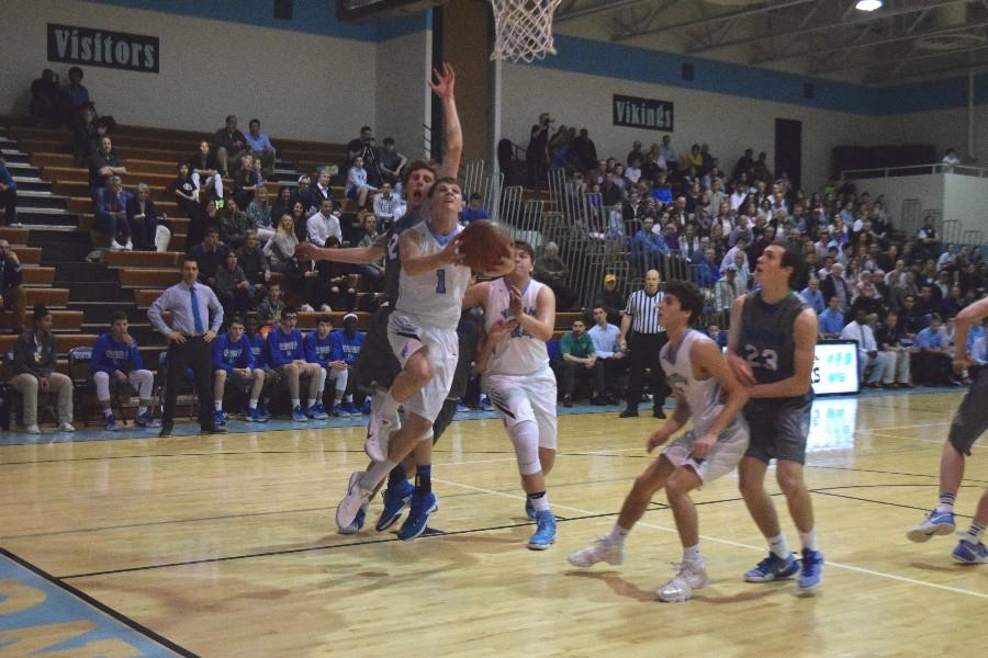 Guard Jack Mclelland goes up for a contested layup as part of his career-high 24 point performance. Photo by Rachel Hazan.