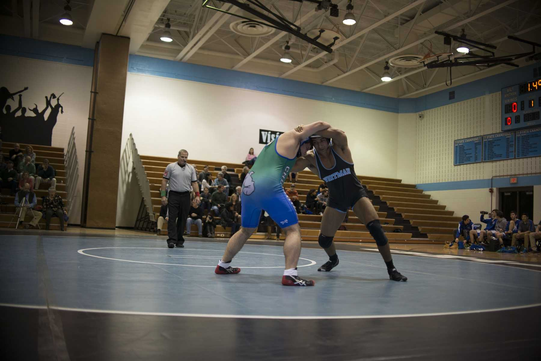 Junior John Luke Iglesias goes head to head with a Churchill opponent in a match on January 27th. Photo by Annabelle Gordon.