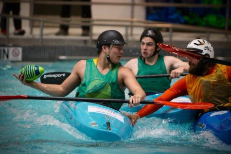 Veterans and students unite for Team River Runner's kayak football tournament