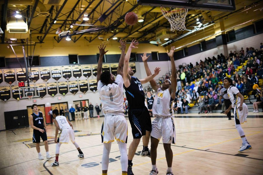 Forward Kieran Kindig goes up for a layup in the team's tight loss to RM. Photo by Tomas Castro.