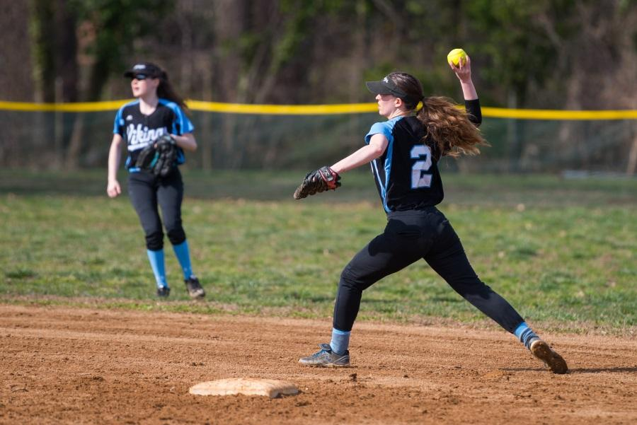 Infielder Laura May throws the ball across the diamond in the team's 17–4 loss against Seneca Valley. Photo by Jefferson Luo.
